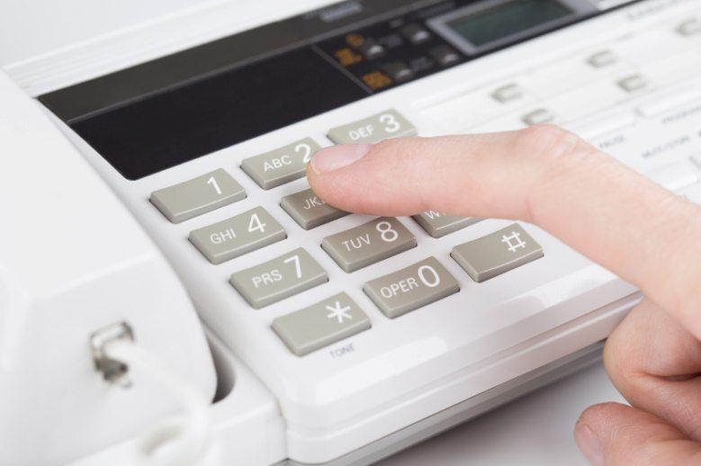 finger on a calculator